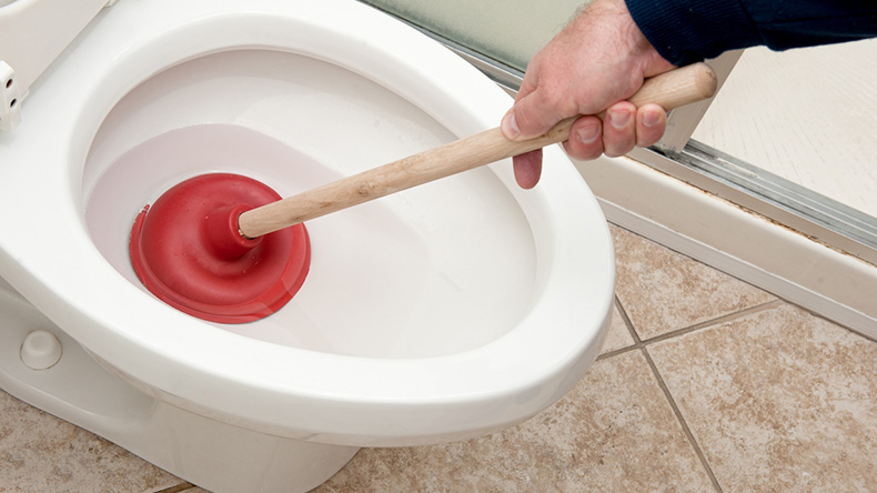 plunging a toilet